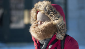 Woman feeling cold in Canada